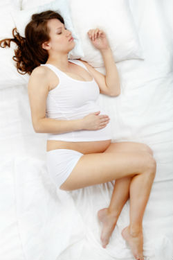 Schwangere Frau Bett