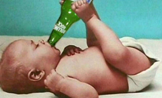 funny baby is drinking beer