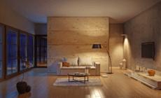 Modern eingerichtetes Wohnzimmer mit verschiedenen Lichtquellen und Abendlicht