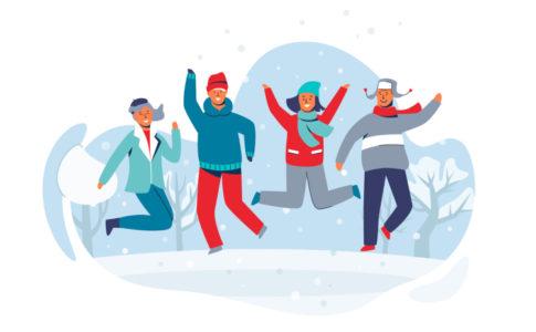 Familie die im Schnee springt